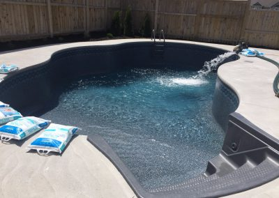 Finished Pool Being Filled